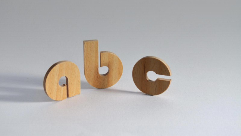 Wooden letters can be CNC routed out of beech plywood. They are thin, practical and economical.