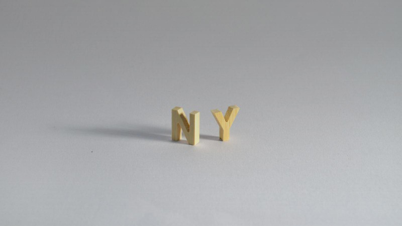 Wooden letters can be CNC routed out of bamboo. They look great, and the 3D effect really stands out.