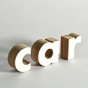 Wooden letters can be CNC routed out of plywood. They look great, and the 3D effect really stands out.